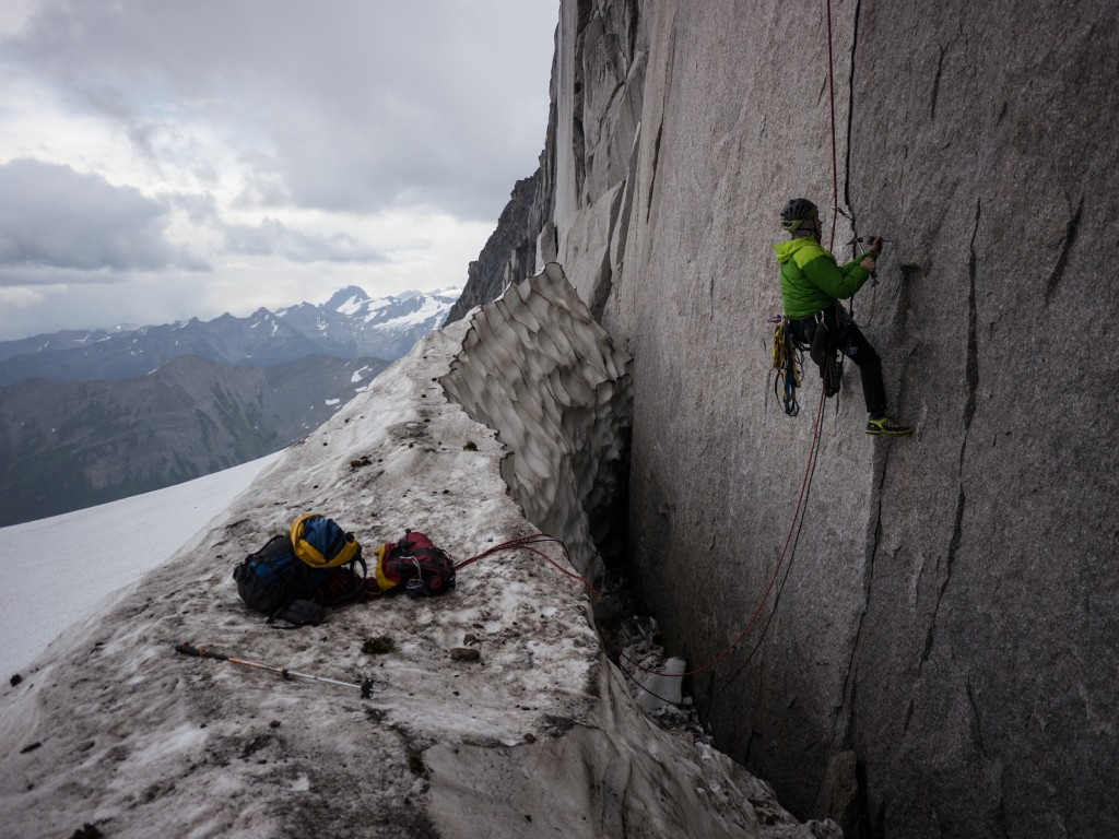 Chris placing a hand drilled bolt while on rappel –prepping the route for the future attempts.